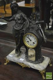 Sale 8359 - Lot 1056 - Early 20th Century French Marble and Spelter Mantle Clock, with spelter figure of literature and raised on gilt metal feet.
