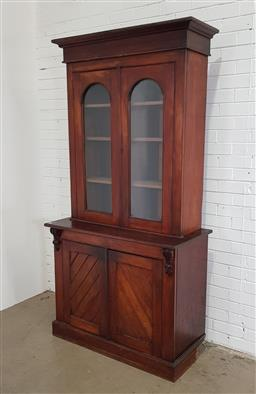 Sale 9183 - Lot 1020 - Late 19th Century Cedar Aesthetic Bookcase, with two arched glass panel doors, above two diagonal timber panel doors, raised on plin...