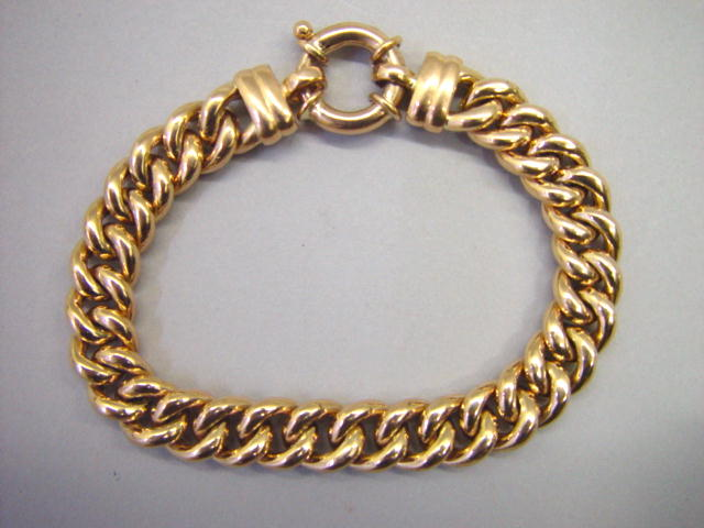Sale 3545 - Lot 87 - A 9CT ROSE GOLD CURB LINK BRACELET;