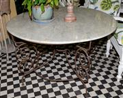 Sale 8080A - Lot 2 - A circular granite top table with scrolled iron base, diameter 131cm