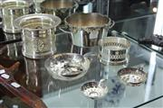 Sale 8151 - Lot 27 - Silver Plated Bottle Coasters & Labels & French Wine Tasters