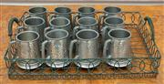 Sale 8990H - Lot 98 - A group of twelve pewter tankards in a wirework tray