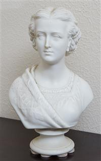 Sale 9080H - Lot 41 - Alexandra Princess of Wales Parian porcelain bust circa 1862 after sculpture  by DF.M. Miller made by W.T. Copeland.  H 30.8 cm W 18...