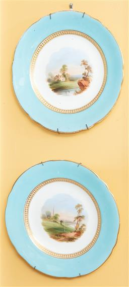 Sale 9120H - Lot 203 - A pair of C19th porcelain cabinet plates with landscapes within sky blue and gilt border, Diameter 23cm