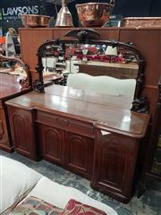 Sale 8868 - Lot 1013 - Victorian Carved Mahogany Breakfront Sideboard, with mirror back surmounted by eagle, centre drawer & four arched panel doors