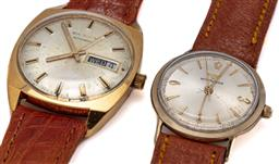 Sale 9090J - Lot 388 - TWO VINTAGE WRISTWATCHES; a Waltham automatic with sunburst dial, center seconds, day date, 25 jewel ETA 2789 movement, gold plated...