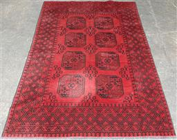 Sale 9126 - Lot 1127 - North Afghan Turkmen Wool Carpet, with two columns of large guls, in red and black tones (239 x 165cm)