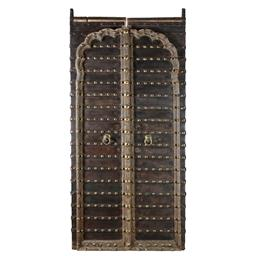 Sale 9245T - Lot 67 - A pair of vintage Indian teak and iron clad doors with brass details. Dimensions: H 245 x W 117 x D 10cm
