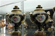 Sale 7977 - Lot 17 - Pair of French Porcelain Blue and Gilt Lidded Urns with Hand Painted Floral Cartouches