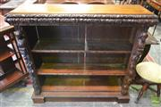 Sale 8255 - Lot 1036 - Late 19th Century Flemish Oak Bookshelf, the fascia carved with busts and fruit & having two shelves