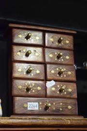 Sale 8405 - Lot 2264 - Brass Inlaid Chest 9 Drawers
