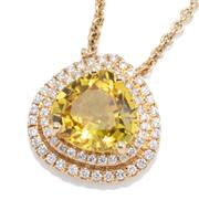 Sale 8937 - Lot 419 - AN 18CT GOLD DIAMOND AND GEMSET PENDANT NECKLACE; centring an heart shape synthetic yellow sapphire to a 2 row border set with 63 ro...