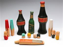 Sale 9190 - Lot 83 - A collection of timber wears inc creative building blocks, carved bottles and a toothpaste (H:29.5cm)
