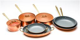 Sale 9246 - Lot 47 - A group of copper cooking wares with brass handles and teflon lining incl. three graduating pots, two graduating frying pans and oth...