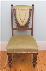 Sale 8470H - Lot 363 - An Edwardian mahogany occasional chair upholstered in pistachio green velvet and raised on turned legs