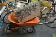 Sale 8530 - Lot 2125 - Orange Westmix Wheelbarrow with a Timber Case