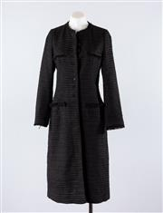 Sale 8760F - Lot 83 - A black, heavily textured woven jacket by Zara, with fringe trim and buttoned front, size EUR medium