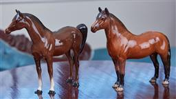 Sale 9103M - Lot 461 - A Beswick Dartmoor horse figure, repair to ear, together with a swish tail example Height 16.5cm