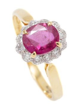 Sale 9209J - Lot 379 - AN 18CT GOLD RUBY AND DIAMOND CLUSTER RING; centring an approx. 0.87ct oval cut ruby surrounded by 12 round brilliant cut diamonds t...