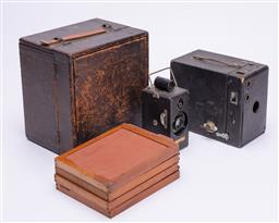 Sale 9185E - Lot 112 - A group of three vintage cameras including a small memo camera, together with The mechanical Eye book
