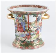 Sale 8536 - Lot 31 - Chinese famille rose vase with two gilt handles, decorated with traditional figures, Chien-Lung marks to base, H18cm