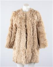 Sale 8760F - Lot 78 - A womens textured fur coat with lambskin shell by Zara Womens Studio, EUR medium