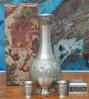 Sale 8990H - Lot 37 - A Thai pewter drink set comprising decanter and shot glasses in original packaging together with a Malaysian pewter trinket box