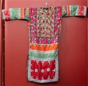 Sale 9020H - Lot 38 - A vintage Northrn Indian tunic in bright colours and mirror embelishment sequins L-92cmx W-100