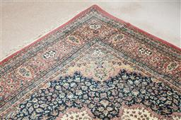 Sale 9103M - Lot 587 - A large machine woven carpet with dusty pink and blue central medallion on a cream ground 302cm x 402cm