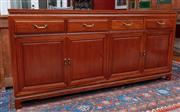 Sale 9020H - Lot 37 - A Chinese rosewood four door four drawer sideboard H-86xW183xD48cm