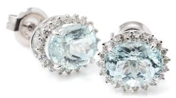 Sale 9149 - Lot 452 - A PAIR OF AQUAMARINE AND DIAMOND CLUSTER STUD EARRINGS; each centring an oval cut aquamarine to surround of 20 round brilliant cut d...