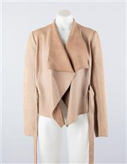 Sale 8760F - Lot 129 - A Scanlan & Theodore beige leather and silk lined wrap jacket, size 12