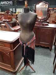 Sale 8848 - Lot 1077 - Edwardian Dress Makers Mannequin, with black cloth torso, on turned pedestal & feet (missing one timber button to shoulder)
