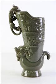 Sale 8952 - Lot 29 - Celadon Chinese Vase featuring foo lions (H29cm)