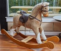Sale 9080H - Lot 57 - A Mamas and Papas rocking horse, Height 85cm x Width 119cm