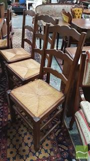 Sale 8402 - Lot 1025 - Set of Eight Oak Provincial Style Ladder Back Dining Chairs with Rush Seats