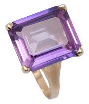 Sale 9046 - Lot 502 - A 9CT GOLD AMETHYST COCKTAIL RING; featuring a step cut amethyst of approx. 7.20ct, size M1/2, top 14 x 12mm, wt. 4.30g.