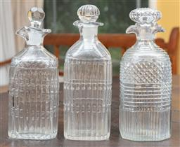 Sale 9120H - Lot 210 - A group of three early cut glass decanters in various designs, Height of tallest 21cm