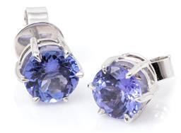 Sale 9149 - Lot 450 - A PAIR OF SOLITAIRE TANZANITE STUD EARRINGS; claw set in 18ct white gold with 2 round cut tanzanites totalling approx. 2.84ct, width...