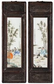 Sale 8536 - Lot 34 - Pair of Chinese timber framed porcelain plaques, decorated with elders and a boy under bamboo trees with calligraphy detail, timber...