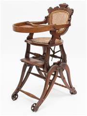 Sale 8980J - Lot 73 - A childs antique metamorphic high - low chair C: 1895, adjustable to 3 positions. One a high chair, two: a push chair on wheels, th...