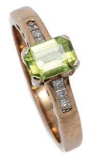 Sale 9046 - Lot 560 - A PERIDOT AND DIAMOND RING; set in 9ct gold with a step cut peridot to shoulders set with 6 princess cut diamonds totalling approx....