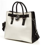 Sale 9090F - Lot 133 - A MICHAEL KORS TOTE BAG; black and white with contrast trim, silvertone hardware, rolled handles with rings and chain inset shoulder...