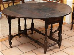 Sale 9120H - Lot 211 - An oak oval gateleg table, Height 71cm x Width extended 140cm x Depth 115cm