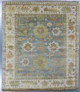 Sale 9248H - Lot 232 - A Rajasthan lambswool natural dye Oushak Rug in soft teal and pistachio tones. 297x253cm
