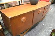 Sale 8364 - Lot 1089 - Beautility Teak Bow-Front Sideboard