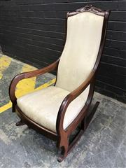 Sale 9031 - Lot 1025 - Carved Mahogany Rocking Chair, with rose crest & upholstered in a cream striped floral fabric (h:105 x w:59cm)