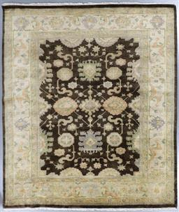 Sale 9248H - Lot 147 - A Rajasthan lambswool natural dye Oushak Rug in chocolate and caramel tones. 298x248cm