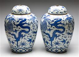 Sale 9253 - Lot 225 - A pair of large Chinese blue and white ceramic lidded urns featuring dragons (H:41cm) - some glazing irregularities