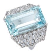 Sale 8937 - Lot 375 - A PLATINUM AQUAMARINE AND DIAMOND COCKTAIL RING; centring an approx. 15ct rectangular cut aquamarine between trapezoid form shoulder...